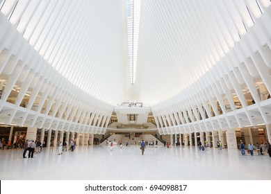 NEW YORK - SEPTEMBER 8: Oculus interior of the white World Trade Center station with people on September 8, 2016 in New York. The station was designed by Santiago Calatrava, Spanish architect.