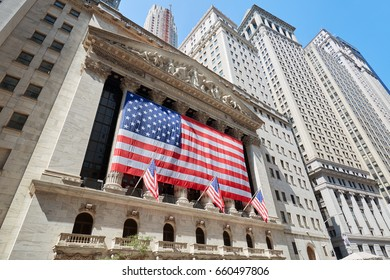 NEW YORK - SEPTEMBER 8: Wall Street Stock Exchange building with big US flag wide angle view, financial district in New York in a sunny day on September 8, 2016 in New York