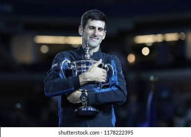 NEW YORK - SEPTEMBER 9, 2018: 2018 US Open champion Novak Djokovic of Serbia posing with US Open trophy during trophy presentation after his final match victory against Juan Martin del Potro