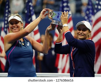 NEW YORK - SEPTEMBER 9, 2018: 2018 US Open women's doubles champions Ashleigh Barty of Australia (R) and CoCo Vandeweghe of USA during trophy presentation after final match at  National Tennis Center
