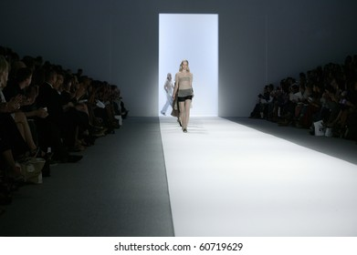 NEW YORK - SEPTEMBER 9: A model is walking the runway at the Richard Chai Collection for Spring/Summer 2011 during Mercedes-Benz Fashion Week on September 9, 2010 in New York.
