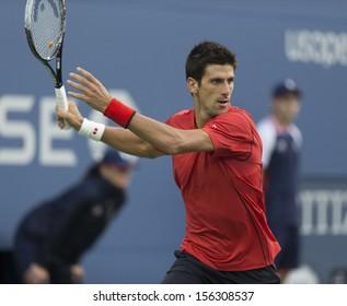 NEW YORK - SEPTEMBER 9: Novak Djokovic of Serbia returns ball during US Open final match against Rafael Nadal of Spain at USTA Billie Jean King National Tennis Center on September 9, 2013 in New York