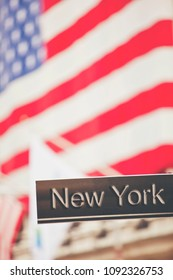 New York sign with New York Stock Exchange flag background