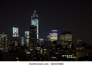 New York skyline at night as seen from the West Village.