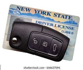 New York State driver license and car key isolated on white background.