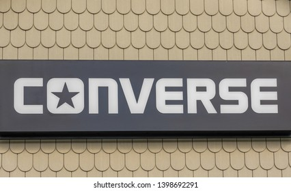 New York State, USA-April 22, 2019: Signage on Converse store. Converse is an American shoe company which sells  sportswear and lifestyle brand footwear. It is a subsidiary of Nike, Inc.