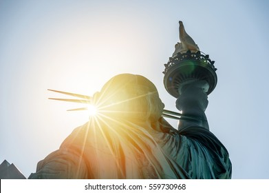 New York; statue of liberty in the sunset