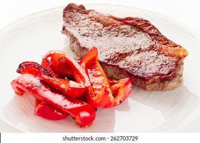 New York steak with grilled bell pepper, close-up