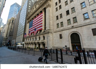 New York Stock Exchange after the Coronavirus Outbreak with Woman in Mask Walking By at 11 Wall Street, New York, NY, USA on March 21, 2020