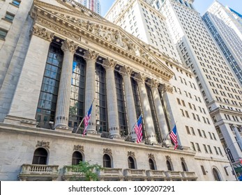 New York Stock Exchange facade with flags, Manhattan, New York, NY, USA on the 30th of July, 2017