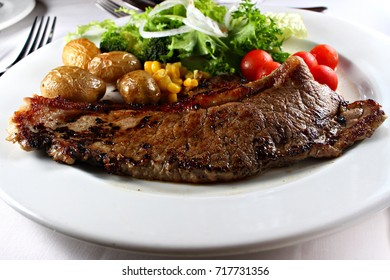New York Strip Steak with Vegetables, shallow focus