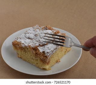 New York style Crumb Cake on a white plate