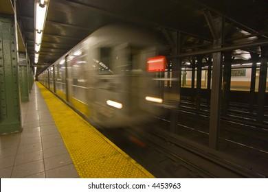 New York subway speeding by a platform with motion blur