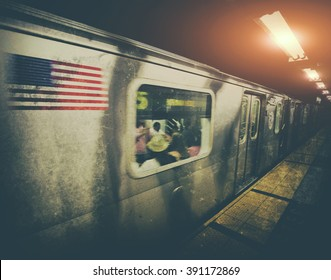 New York subway train moving through station with vintage filter effect