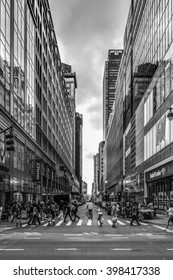 New York, United Stated of America - September 20, 2015: People crossing W33rd Street on the Avenue of the America's, or Sixth Avenue, in Manhattan on a September evening in 2015 in black and white