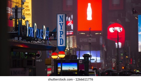 NEW YORK - UNITED STATES - 03 NOVEMBER 2018. Billboards and a NYPD office in Times Square. Times Square is an iconic square of New York City, United States.
