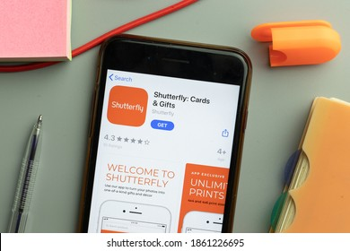 New York, United States - 7 November 2020: Phone screen close-up with Shutterfly mobile app logo on display, Illustrative Editorial.