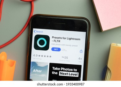New York, United States - 7 March 2021: Phone screen close-up with Presets for Lightroom FLTR mobile app logo on display, Illustrative Editorial.