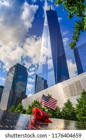 New York, United States of America - June 2016: View of the World Trade Center in Lower Manhattan against a deep blue sky. Freedom Tower, the tallest building in the Western Hemisphere. New York, USA