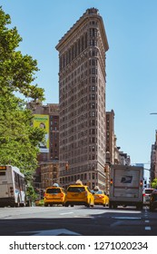 New York, New York, United States of America - 07072018: Flatiron building and yellow taxis at Fifth Avenue in Manhattan