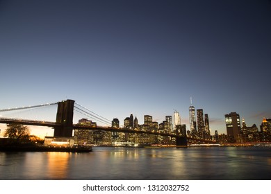 New York, United States of America - November 18, 2016: Skyline of Lower Manhattan with Brooklyn Bridge at sunset.