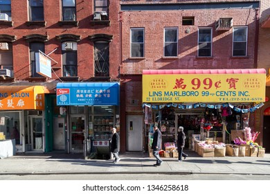 New York, United States of America - November 11, 2016: People in front of stores in Chinatown district in Lower Manhattan.