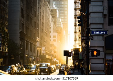 NEW YORK, NEW YORK/ UNITED STATES OF AMERICA - NOVEMBER 14. 7:07 am Morning of the Supermoon. Sunrise filling 39th st.  Daily commuters are just starting to arrive and traffic starting to build.
