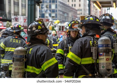 New York, United States of America - November 20, 2016: Group of firemen waiting in front of the  Grand Central Market in Manhattan