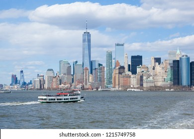 New York, New York / United States - April 5, 2018: A Circle Line Cruise boat travels along the Hudson River