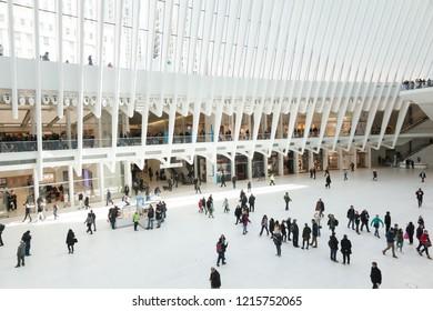 New York, New York / United States - April 5, 2018: People enjoy the inside of Lower Manhattan's Oculus