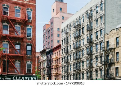 New York, New York / United States - August 6 2015: Exterior of New York apartment building facades above intersection of 3rd st and 1st avenue in Lower East Side neighborhood of Manhattan