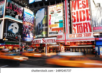 New York, United States - December 11, 2010: Nighttime in Times Square features with Broadway Theaters and is a symbol of New York City.