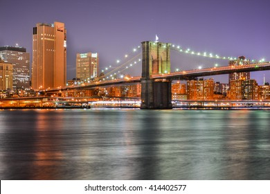 NEW YORK, UNITED STATES - DECEMBER 30, 2015 - landscape of skyscrapers from the big night brooklyn bridge