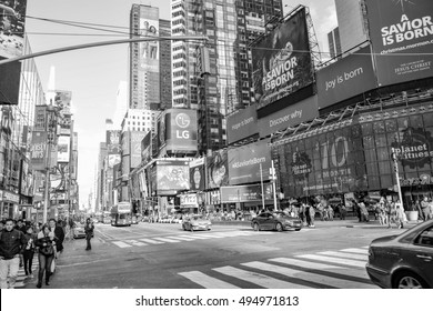NEW YORK, UNITED STATES - DECEMBER 29, 2015 -   Times Square is a major commercial intersection and a neighborhood in Midtown Manhattan, New York City. Black and white photo.