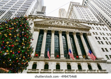 NEW YORK, UNITED STATES - DECEMBER 28, 2015 - Famous Wall street and the building in New York, New York Stock Exchange with Christmas Tree