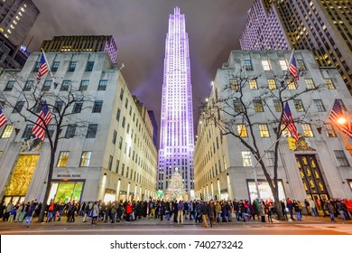 NEW YORK, UNITED STATES - DECEMBER 30, 2015 -  Night in  Rockefeller Center all decorated surrounding the newly lit Christmas tree.