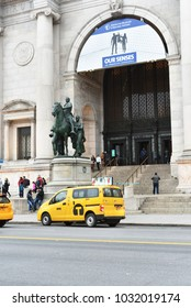 New York, United States - Feb 19: Exterior of New York's American Museum of Natural History just across from Central Park, seen with famous yellow cab on street, February 19th, 2018