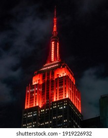 New York, United States - February 2021: Empire State Building illuminated in red lights.