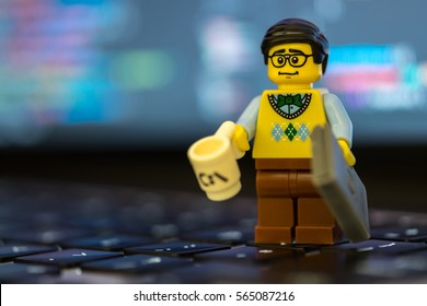 New York, United States - January 22, 2017 - Lego programmer standing on keyboard with code in background