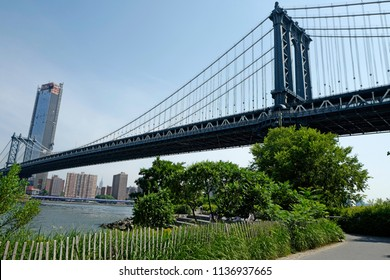 NEW YORK, UNITED STATES, JUNE 18, 2018: Manhattan bridge seen from the Brooklyn park, in New York.
