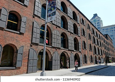 NEW YORK, UNITED STATES, JUNE 18, 2018: old buildings under the Brooklyn bridge in Dumbo, in New York.