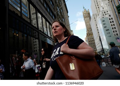 NEW YORK, UNITED STATES, JUNE 16, 2018: woman looks on walking on the 5th Avenue of Manhattan, in New York.