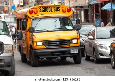 New York, United States, June 4, 2013: Yellow school bus driving through the streets of Chinatown in New York city, New York