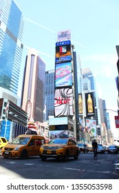 New York / United States - June 20, 2014 ; time square view from New York city. people walking on the street.
