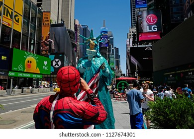 NEW YORK, UNITED STATES JUNE-14, 2018: American icons masks of Spider Man and Liberty Statue in Times Square , in New York.