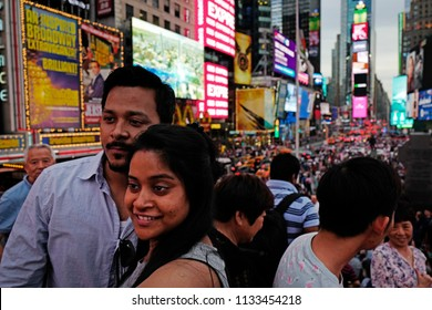 NEW YORK, UNITED STATES, JUNE-17, 2018: tourists selfie at Times Square when the lights are turned on, sunset in Manhattan, in New York.