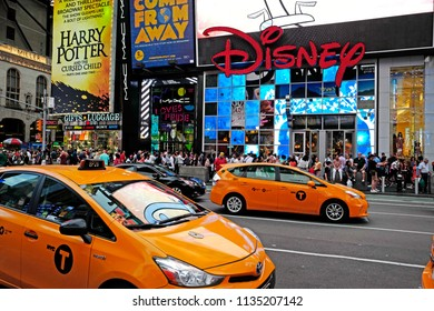 NEW YORK, UNITED STATES, JUNE-17, 2018: nyc taxi cabs at Times Square in front of the Disney store, in Manhattan, in New York.