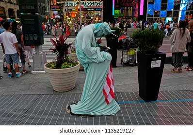 NEW YORK, UNITED STATES, JUNE-17, 2018: Liberty statue masked man in Manhattan, in New York.