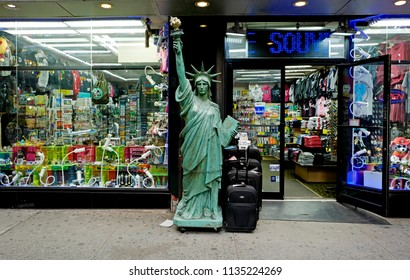 NEW YORK, UNITED STATES, JUNE-17, 2018: chained Liberty statue, in front of a tourist souvenir shop in Manhattan, in New York.
