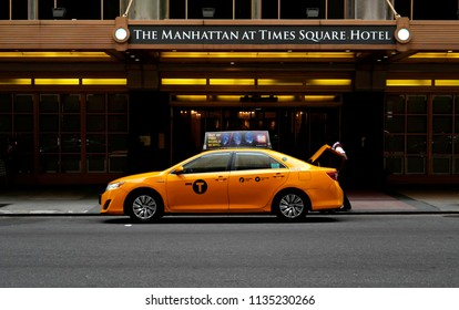 NEW YORK, UNITED STATES, JUNE-17, 2018:  nyc yellow cab in front of The Manhattan at Times Square Hotel, in Manhattan, in New York.